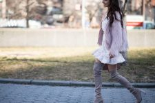 With white ruffled mini dress, belt, lilac faux fur jacket and bag