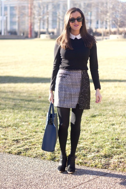 With white shirt, black sweater, blue tote bag and black ankle boots