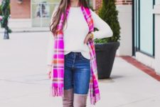 With white sweater, hot pink plaid scarf and jeans
