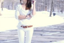 With white sweater, white skinny jeans and brown leather belt