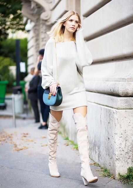 With white sweatshirt dress and blue chain strap bag