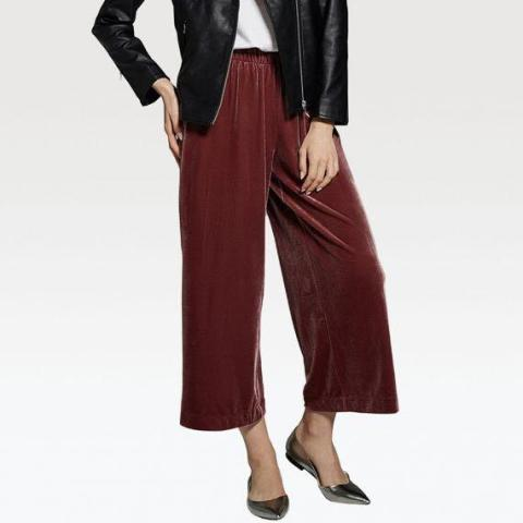 With white t shirt, black leather jacket and silver flat shoes