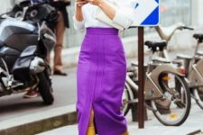 With white turtleneck, white shirt, white clutch and lilac midi skirt