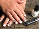 a simple black and white zombie Halloween nail art is a stylish and contrasting idea for this cool party