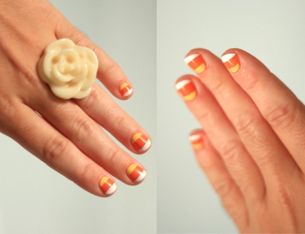 striped Halloween nails inspired by candy corn are a cool and bright solution for a party