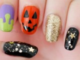 black, gold, purple and rust nails with a biit of art for Halloween are a bold and catchy solution