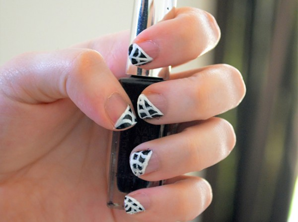 nude nails paired with black and white spiderweb is a stylish idea in a monochromatic color scheme