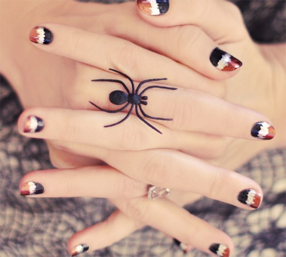 rust, white and black nails inspired by spiders are a very creative idea for Halloween