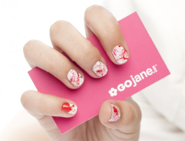 red and white bloody nails are a bold and catchy solution to rock for Halloween, enjoy such a creative look