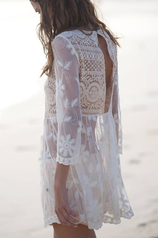 a white semi sheer lace mini dress with a cutout back is a trendy piece for a boho girl