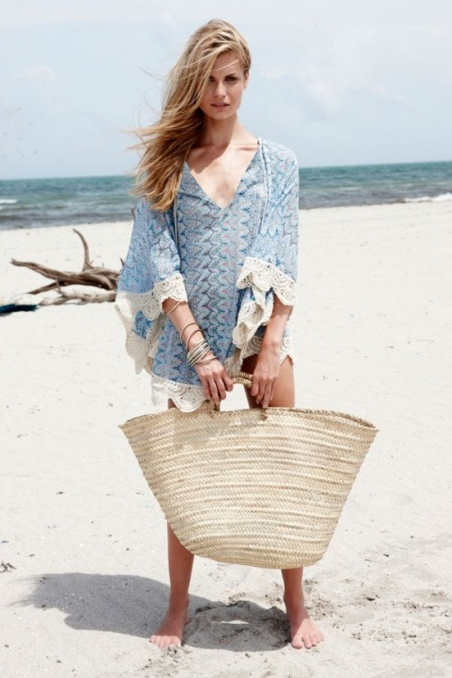 a blue and white lace coverup with long sleeves is ideal to wear over the swimsuit