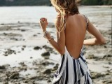 a striped beach maxi dress with an open back is a cool item to wear over your swimsuit or instead of it