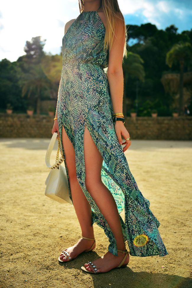 a turquoise halter neckline snakeskin print maxi dress with front slits is a trendy beach dress to go for