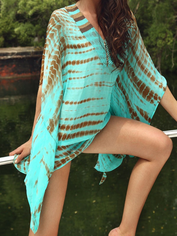 a turquoise and brown beach mini dress with long wide sleeves and a high neckline is very comfy