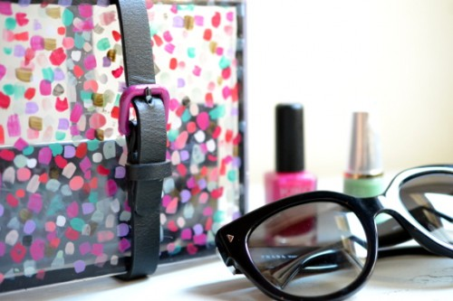 colorful plexuglass and leather clutch (via bornineightytwo)