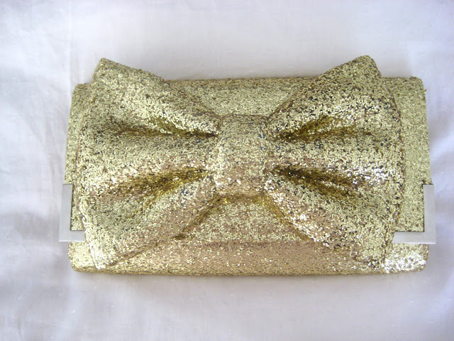 glittery gold bow clutch