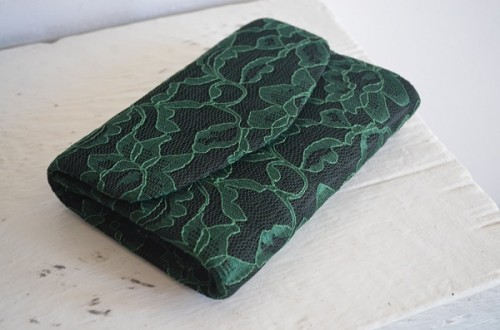 black and green lace clutch (via happinessiscreating)