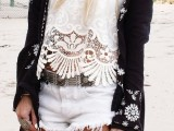 a monochromatic boho outfit with a white lace top, white denim shorts and a black coverup with white embroidery