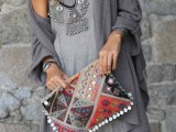 a grey mini dress with a lace edge, a statement necklace and a grey cardigan plus a crazy printed and embroidered boho bag