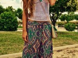 a bright boho look with a white lace top, colorful pants, layered necklaces and a neutral crossbody bag