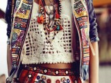 a crazy gypsy and folksy look with a lace crop top, colorful embroidered shorts and a jacket plus layered accessories all over