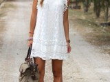 a sexy summer look in a white mini dress