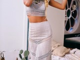 a sexy boho outfit with a grey crochet crop top and a sheath skirt plus a statement necklace