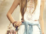 a white boho top and shorts, a denim jacket, a hat and a colorful embroidered bag