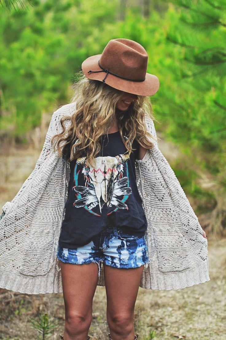 a printed t shirt, tie dye shorts, a crochet cardigan, a hat and necklaces for a boho feel
