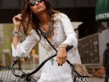 a white boho mini dress with a lace neckline and layered necklaces plus a boho printed crossbody