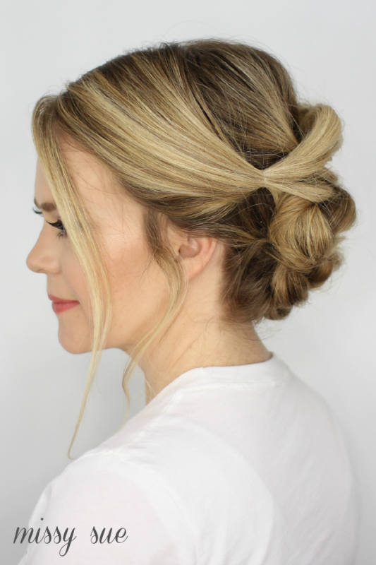 Picture Of chic and classy diy pull thru bun updo to try  2
