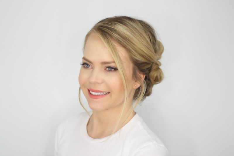 Picture Of chic and classy diy pull thru bun updo to try  3