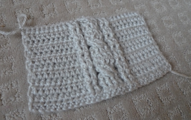 Picture Of comfy diy cable knit wrist warmers  4