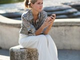 a snakeskin shirt, white palazzo pants blush strappy shoes for a trendy minimal work look