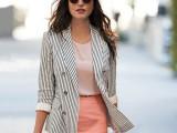 a blush top, a coral mini skirt, a striped long blazer and a black and white bag