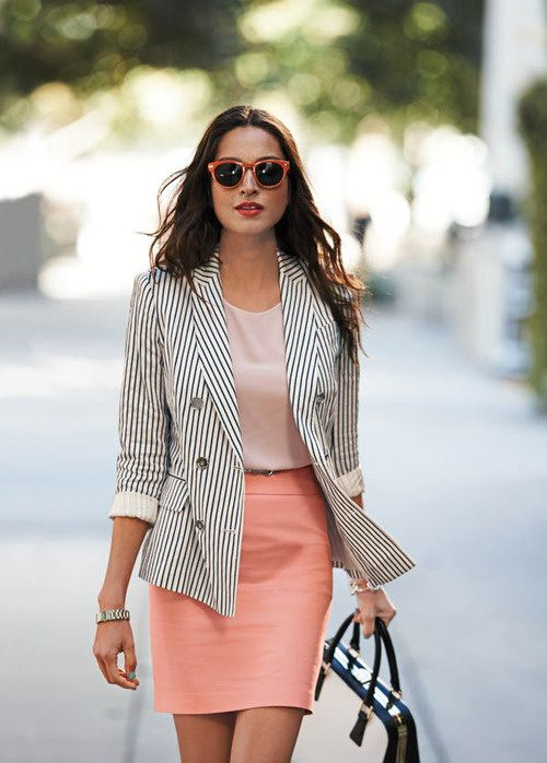 a blush top, a coral mini skirt, a striped long blazer and a black and white bag