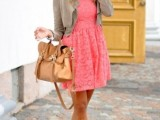 a coral pink lace A-line mini dress, a tan cropped jacket, a cognac bag and matching shoes