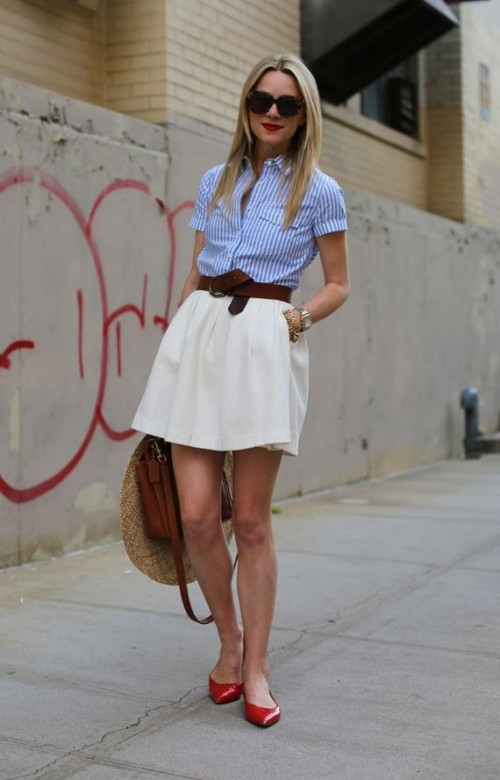a blue striped shirt, a creamy A-line skirt, red flats, a brown belt and bag and a wide brimmed hat