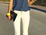 a navy oversized shirt, white jeans, a black clutch and glitter shoes for a bold and chic work outfit