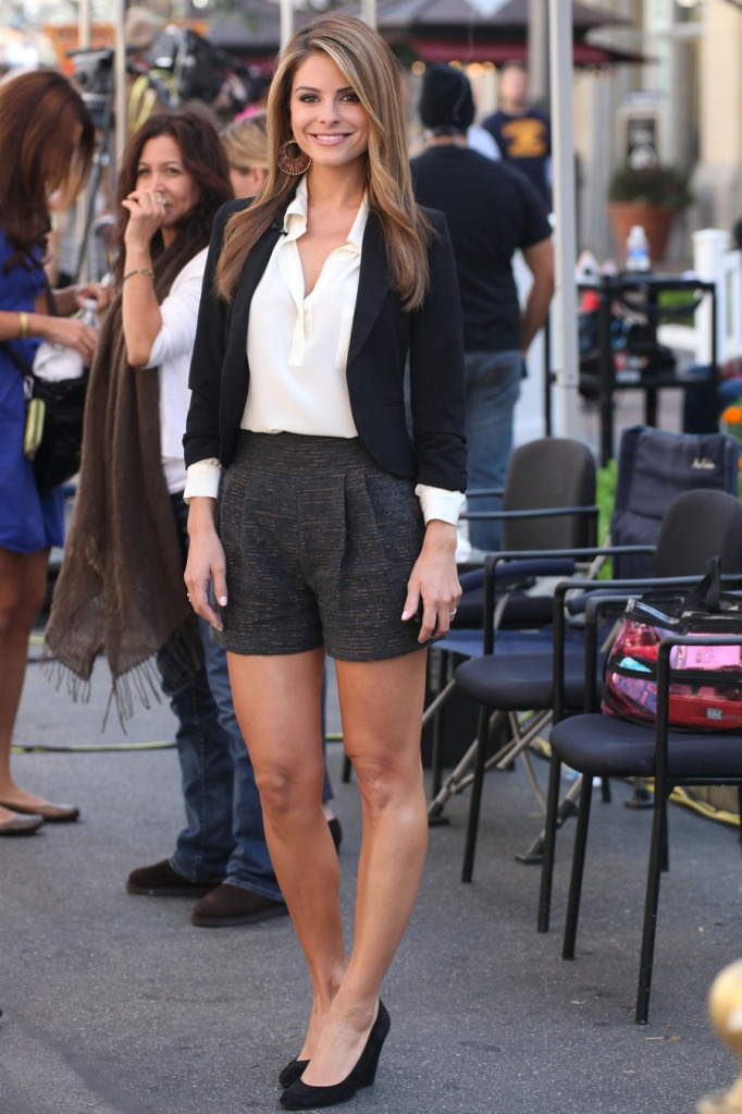 a white shirt, a black blazer, black shorts, black wedges and statement earrings for summer