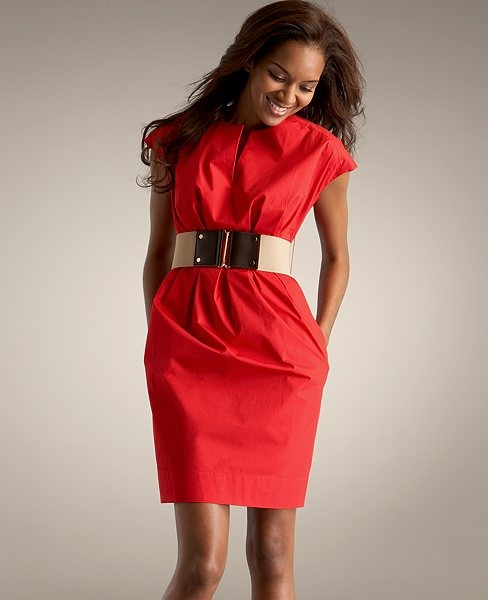 a gorgeous red over the knee dress with cap sleeves and a stunning wide metallic belt to highlight the waist