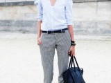 a blue shirt with puff sleeves, grey pants, plaid shoes and a black tote for a spring or summer work look