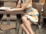 a printed grey and orange sleeveless A-line dress, tan peep toe shoes for a summer work look