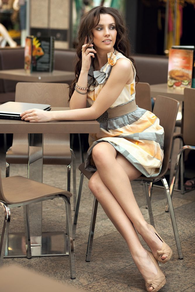 a printed grey and orange sleeveless A line dress, tan peep toe shoes for a summer work look