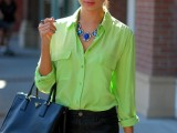 black mini shorts, a neon green shirt, a black tote and a statement necklace