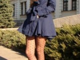 a short navy fitting trench coat with a sash is a stylish idea to wear in spring
