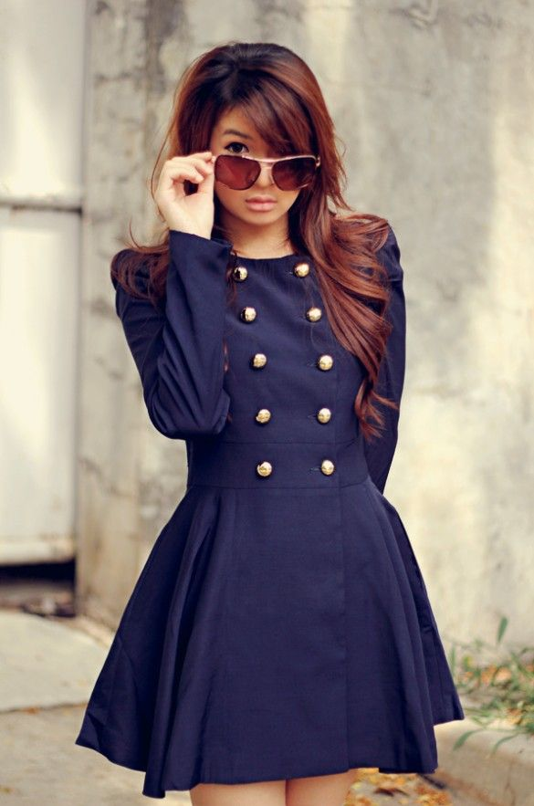 a navy A line mini dress with gold buttons is a refined retro piece to wear anytime