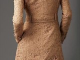 a tan lace fitting midi trench is a very feminine piece to wear in spring, it's soft and very tender