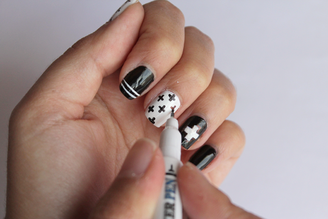 Picture Of diy black and white swiss cross nail art  2
