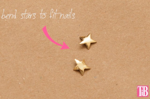Picture Of diy gold star manicure for the holiday season  2